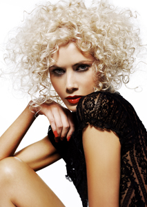 Hot sticks were used to create ringlets on thick blonde hair by Geoffery Herberg
