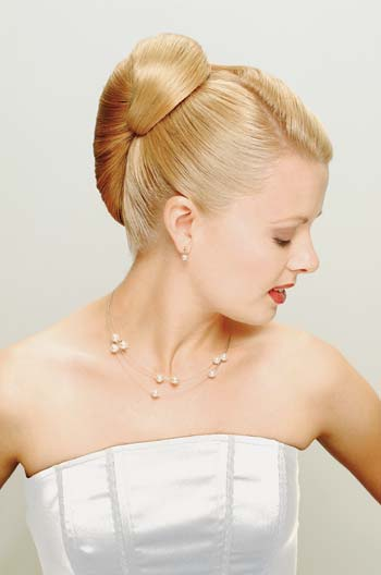 Classic bridal hair the French roll  from Sharon Blain