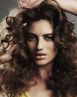 Plenty of root lift and curl makes for big hair by Tracey Devine