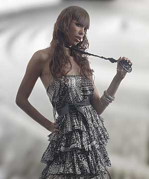 Full staight fringe or bangs mixed with soft curls from SAKS