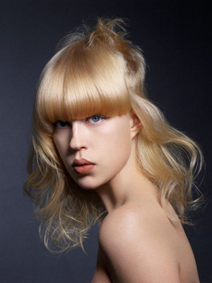 Tim Hartley combines a full straight fringe with soft floaty curls